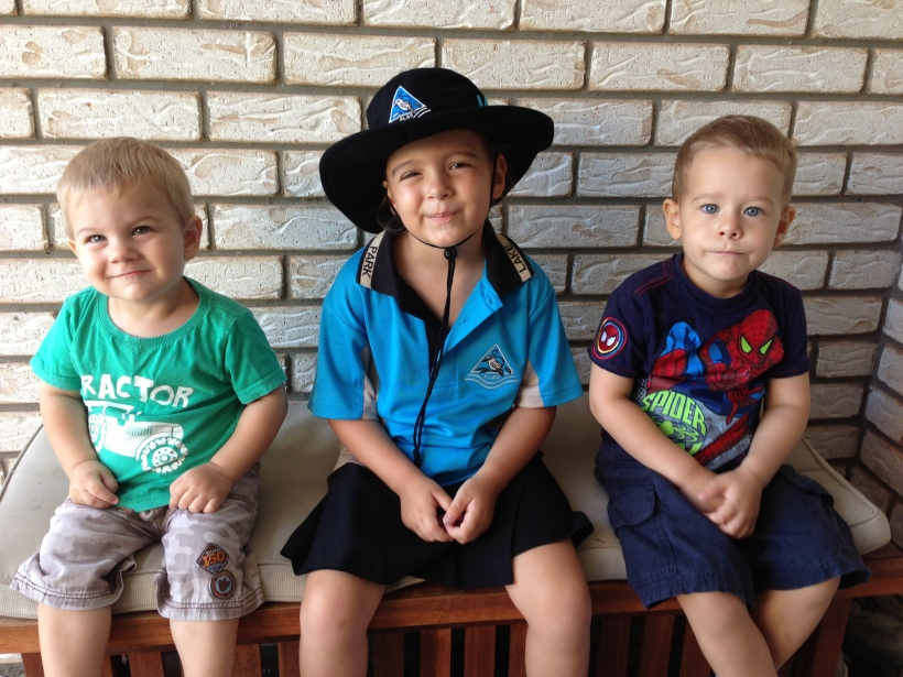 A quick and very staged photo with her younger brothers - CUTE!