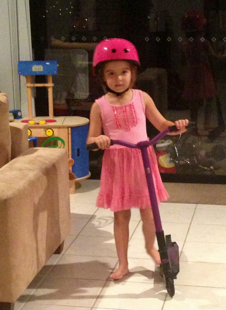 Growing up so fast - she loves to scooter to school!