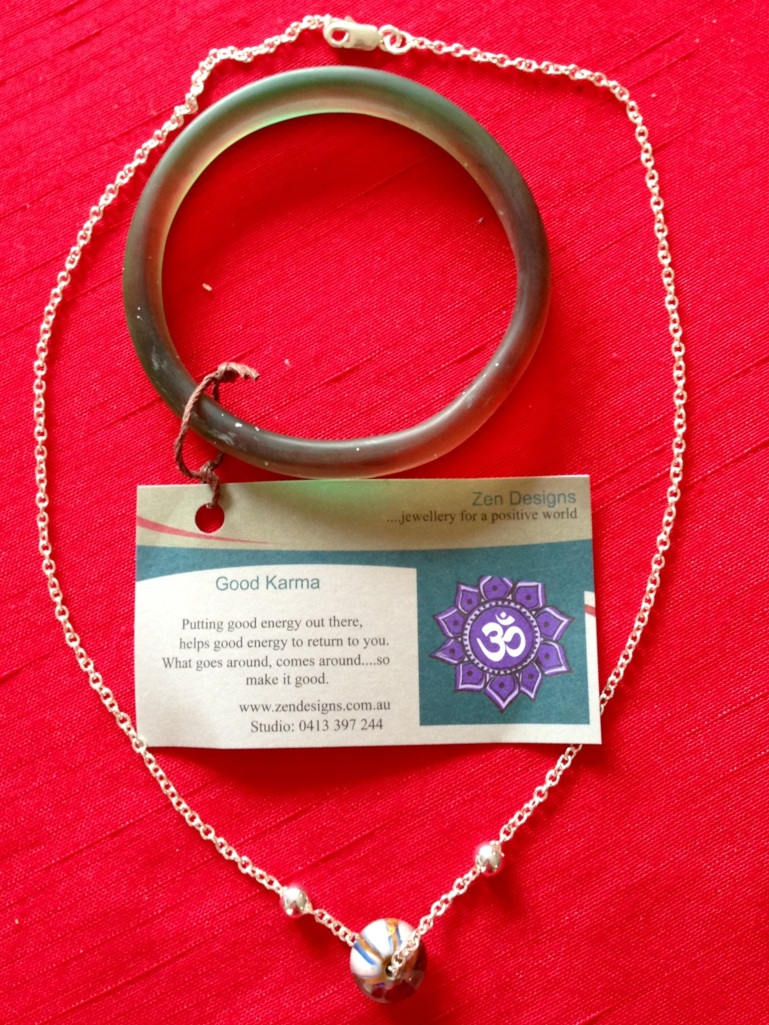 This is a gorgeous, hand-crafted necklace and awesome resin bracelet from Zen designs - http://www.zendesigns.com.au