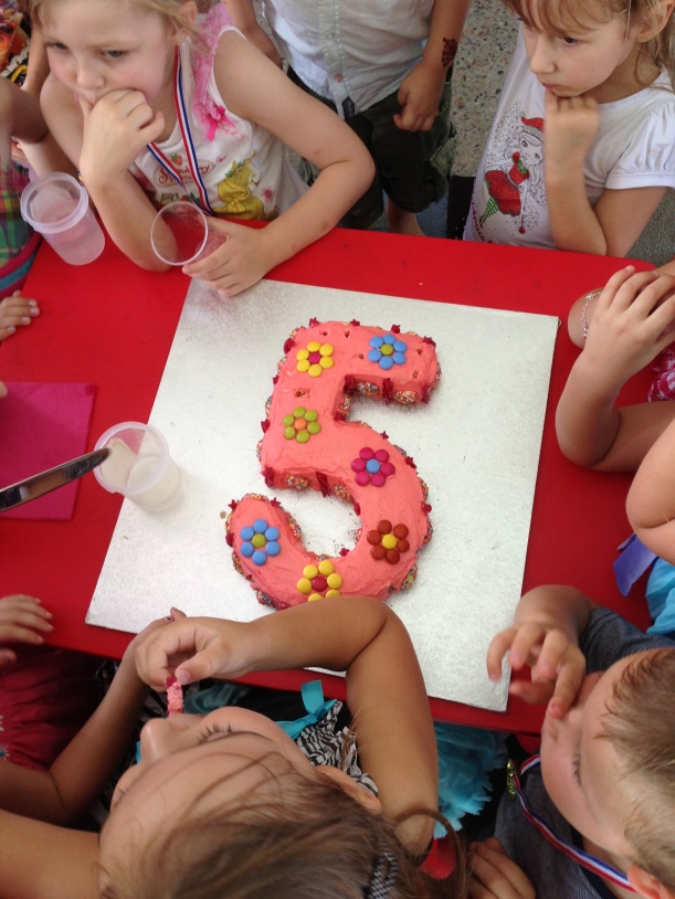A simple numeral for my girl's 5th birthday - lots of greedy hands watching to grab a slice!