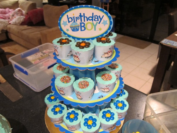 A cupcake stack for my youngest boy's 1st birthday! Was kinda fun making the flowers and trying to get the right colour with mum helping me :)