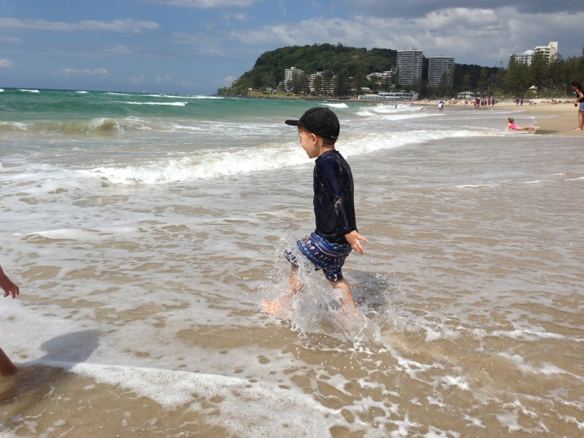 And you can imagine my shock when he ran back into the ocean after just being knocked over by it - that's my boy x