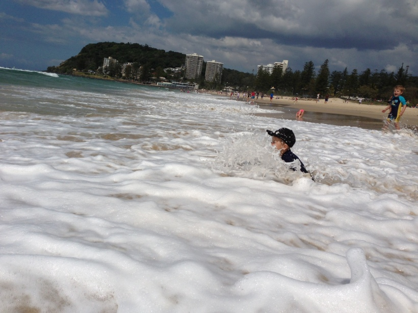 Getting SMASHED by a wave! I promise I ran over to see how he was as soon as I took this photo!