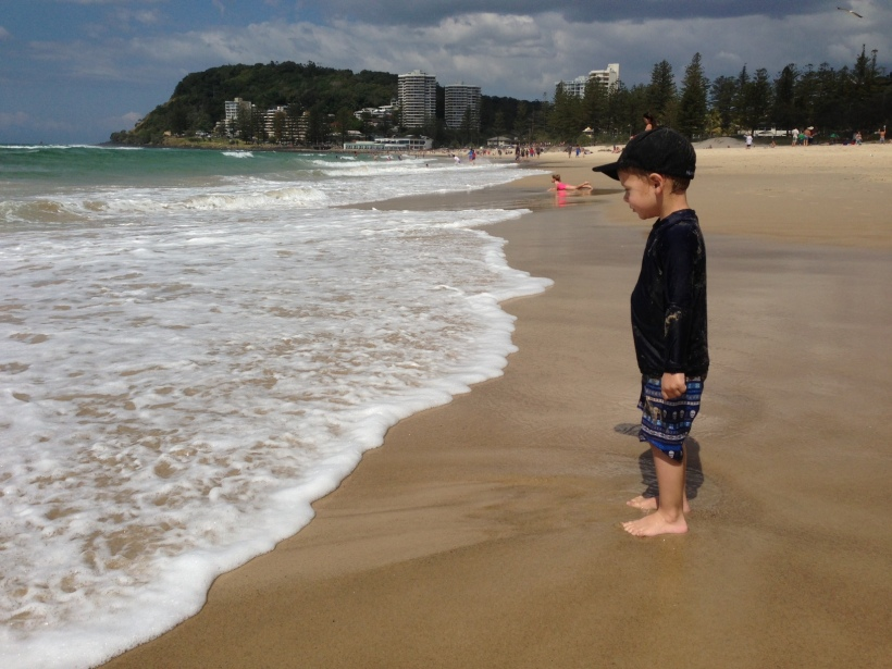 I was convinced he would scream his head off and run away but this is him, minutes after - reading to face the waves - a proud mumma I was!